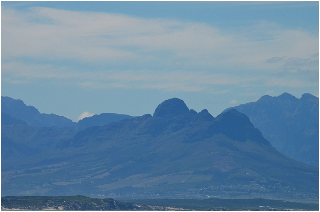 Helderberg mountain seen across False Bay from Muizenberg.